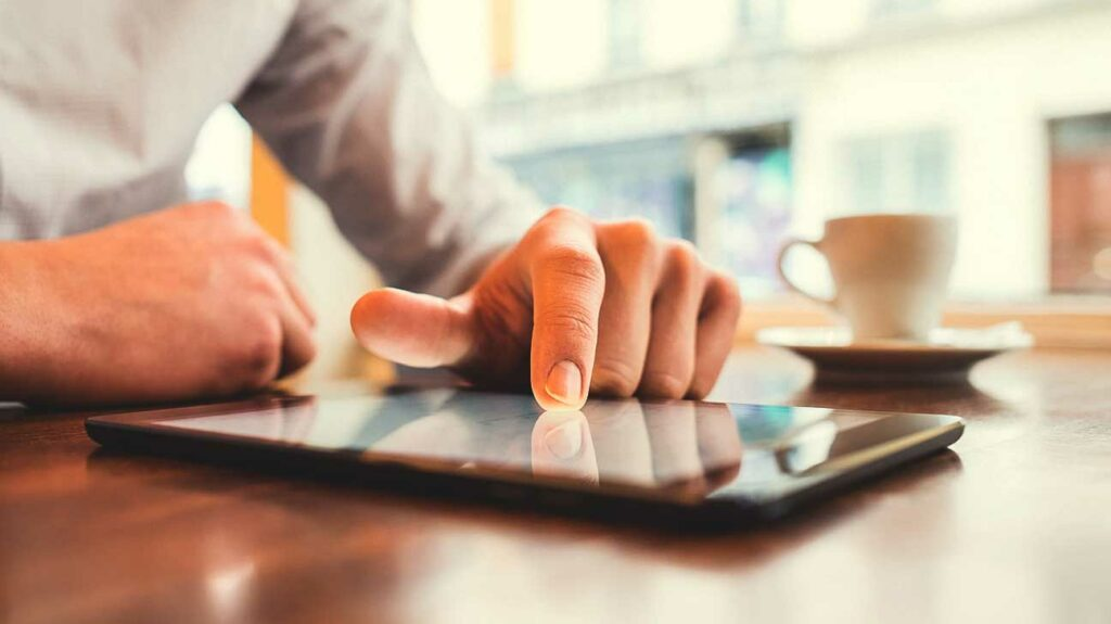 51-Hands man_tablet_coffee-1296x728-header